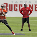 New Tampa Bay Buccaneers head coach Lovie Smith, right, watches quarterback Josh McCown run through drills during a voluntary minicamp football practice Tuesday, April 22, 2014, in Tampa, Fla The Associated Press