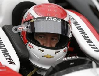 FILE - In this May 18, 2013 file photo, AJ Allmendinger sits in his car during practice on the first day of qualifications for the Indianapolis 500 auto race at the Indianapolis Motor Speedway in Indianapolis. Allmendinger is in the Indianapolis 500 for the first time in his career with the team owner who fired him last summer from the best job of his life. (AP Photo/Darron Cummings, File)