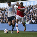 Tottenham Hotspur's Kyle Naughton, left, competes for the ball with Arsenal's Kieran Gibbs during the English Premier League soccer match between Tottenham Hotspur and Arsenal at White Hart Lane stadium in London, Sunday, March 16, 2014