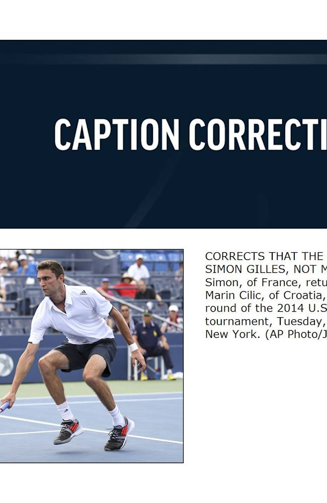 CORRECTS THAT THE PHOTO SHOWS GILLES SIMON, NOT MARIN CILIC -  Gilles Simon, of France, returns a shot against Marin Cilic, of Croatia, during the fourth round of the 2014 U.S. Open tennis tournament, Tuesday, Sept. 2, 2014, in New York