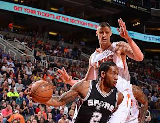 PHOENIX, AZ - FEBRUARY 28: Kawhi Leonard #2 of the San Antonio Spurs drives against the Phoenix Suns on February 28, 2015 at U.S. Airways Center in Phoenix, Arizona. (Photo by Barry Gossage/NBAE via Getty Images)
