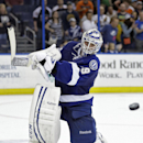 Tampa Bay Lightning goalie Anders Lindback (39), of Sweden, clears the puck to the corner in the final seconds of an NHL hockey game against the Philadelphia Flyers on Thursday, April 10, 2014, in Tampa, Fla. The Lightning won 4-2 The Associated Press
