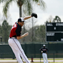 Atlanta Braves first baseman Freddie Freeman can't field the cutoff throw during a spring training baseball workout, Monday, Feb. 24, 2014, in Kissimmee, Fla The Associated Press