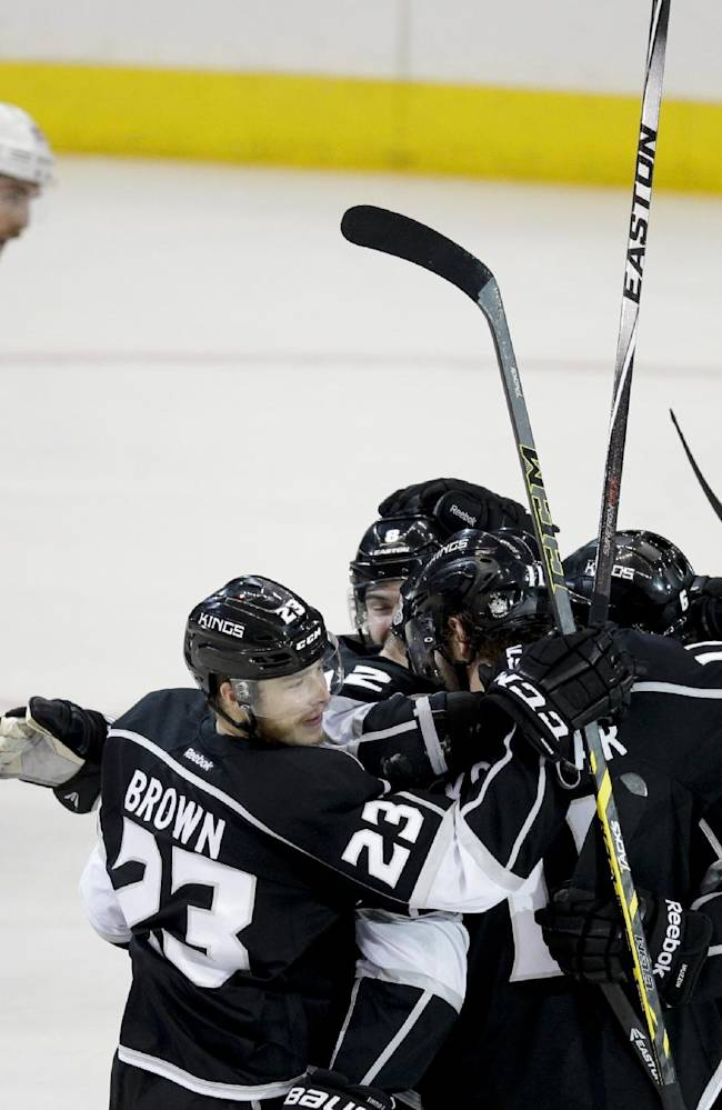 Members of the Los Angeles Kings celebrate Marian Gaborik's goal as New York Rangers defenseman Ryan McDonagh skates by the during the third period of Game 2 in the NHL hockey Stanley Cup Finals in Los Angeles, Saturday, June 7, 2014