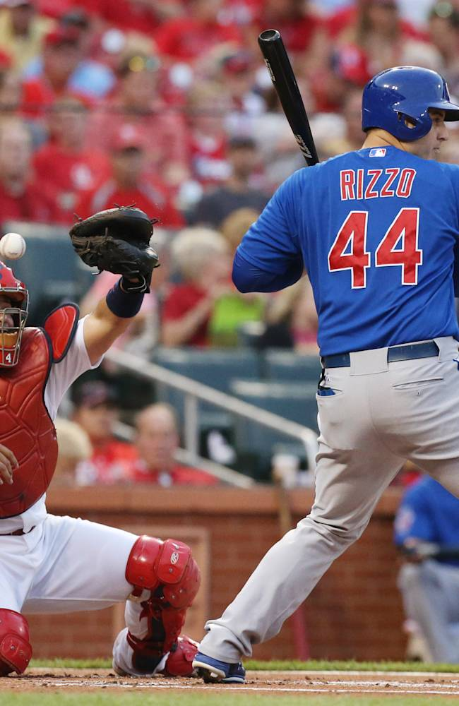 In this May 12, 2014 photo, St. Louis Cardinals catcher Yadier Molina is unable to catch a pitch to Chicago Cubs' Anthony Rizzo from starting pitcher Tyler Lyons that went for a passed ball in the first inning of a baseball game at Busch Stadium in St. Louis.  Chicago Cubs' Emilio Bonifacio scored on the passed ball. The Cubs beat the Cardinals 17-5