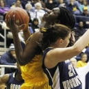 California's Talia Caldwell shoots in front of George Washington's Megan Nipe during the first half of an NCAA women's college basketball game in Berkeley, Calif., Friday, Dec. 28, 2012. (AP Photo/George Nikitin)