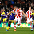 Stoke's Jonathan Walters holds back Swansea's Nathan Dyer during the English Premier League soccer match between Stoke City and Swansea City at Britannia Stadium in Stoke on Trent, England, Wednesday, Feb. 12, 2014