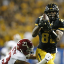 Missouri wide receiver Jimmie Hunt (88) makes the catch against Alabama defensive back Jabriel Washington (23) during the second half of the Southeastern Conference championship NCAA college football game, Saturday, Dec. 6, 2014, in Atlanta. (AP Photo/Brynn Anderson )