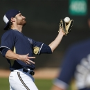 Milwaukee Brewers' Jonathan Lucroy makes a catch on a high pop fly during Brewers spring training baseball practice, Thursday, Feb. 20, 2014, in Phoenix The Associated Press