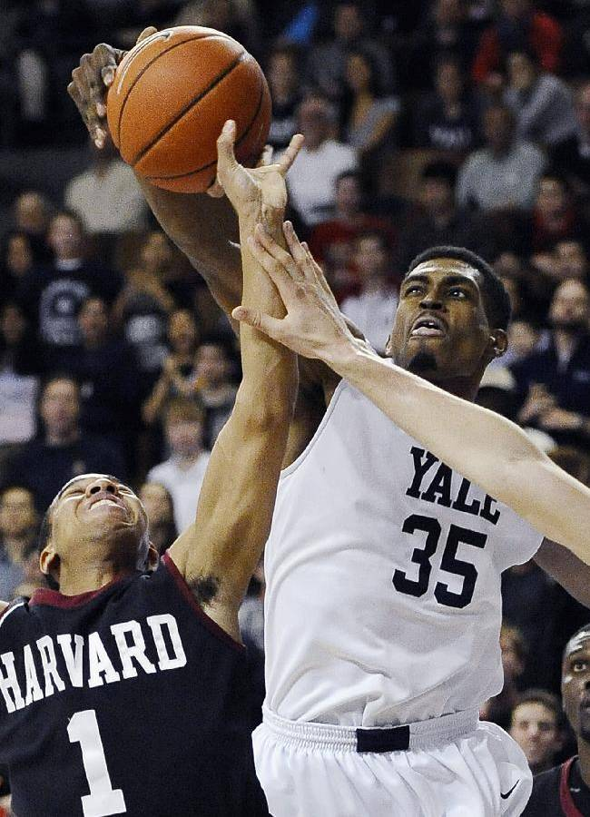 In this March 7, 2014 file photo, Yale's Brandon Sherrod, right, fouls Harvard's Siyani Chambers, left, during the second half of an NCAA college basketball game in New Haven, Conn. Sherrod is taking off from the team's 2014-15 season to tour with the Whiffenpoofs, the school's a cappella singing group