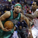 Boston Celtics guard Jerryd Bayless, left, drives to the basket against Detroit Pistons guard Brandon Jennings during the second half of an NBA basketball game Saturday, April 5, 2014, in Auburn Hills, Mich. The Pistons defeated the Celtics 115-111 The As
