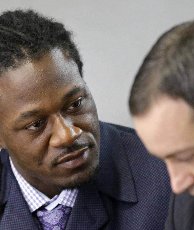 Adam Jones, left, cornerback for the NFL football Cincinnati Bengals, talks with attorney Chad Ziepfel during his assault trial, Monday, Oct. 7, 2013, in Cincinnati. Jones is charged with assaulting a woman at a nightclub