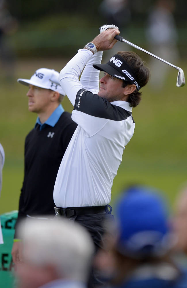 Bubba Watson, right, tees off of the third hole as Hunter Mahan looks on during the second round of the Northwestern Mutual World Challenge golf tournament at Sherwood Country Club, Friday, Dec. 6, 2013, in Thousand Oaks, Calif