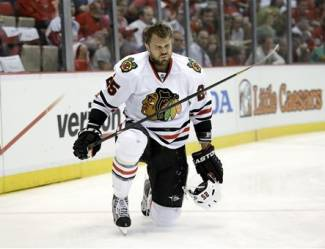Chicago Blackhawks left wing Viktor Stalberg (25), of Sweden, gets up after hitting the wall against the Detroit Red Wings during the first period of an NHL hockey Stanley Cup playoffs Western Conference semifinal game in Detroit, Monday, May 20, 2013. (AP Photo/Paul Sancya)