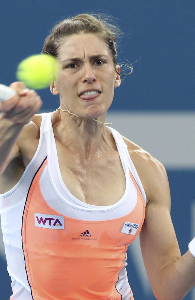 Andrea Petkovic of Germany plays a shot in her 2nd round match against Serena Williams of the USA during the Brisbane International tennis tournament in Brisbane, Australia, Tuesday, Dec. 31, 2013
