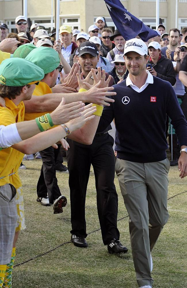 Jason Day, left of Australia and compatriot Adam Scott, right,  are congratulated by fans after winning the team event at the World Cup of Golf at Royal Melbourne Golf Course in Australia, Sunday, Nov. 24, 2013