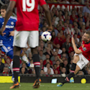 Manchester United's Tom Cleverley, right, fires the ball against Chelsea's Frank Lampard, second left, during their English Premier League soccer match at Old Trafford Stadium, Manchester, England, Monday Aug. 26, 2013. (AP Photo/Jon Super)