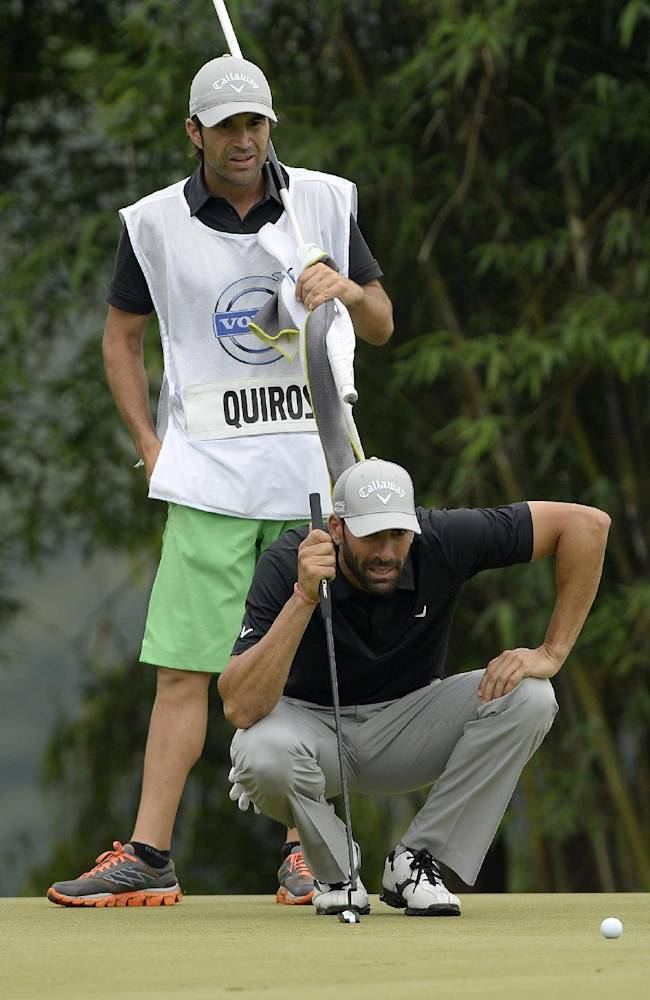 In this photo released by OneAsia, Alvaro Quiros of Spain lines up putt during the third round of the Volvo China Open at Genzon Golf Club in Shenzhen, southern China, Saturday, April 26, 2014