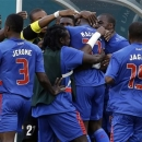 Haiti's Jean Eudes Maurice (11) is congratulated by teammates after scoring a goal against Trinidad and Tobago during the first half of a CONCACAF Gold Cup soccer match on Friday, July 12, 2013, in Miami Gardens, Fla. (AP Photo/Lynne Sladky)