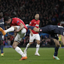Manchester United's Robin van Persie, left, is injured after colliding with Olympiakos's Kostas Manolas during their Champions League last 16 second leg soccer match at Old Trafford Stadium, Manchester, England, Wednesday, March 19, 2014