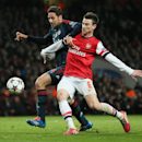 Arsenal's Laurent Koscielny, right, and Bayern's Claudio Pizarro challenge for the ball during a Champions League, round of 16, first leg soccer match between Arsenal and Bayern Munich at the Emirates stadium in London, Wednesday, Feb. 19, 2014