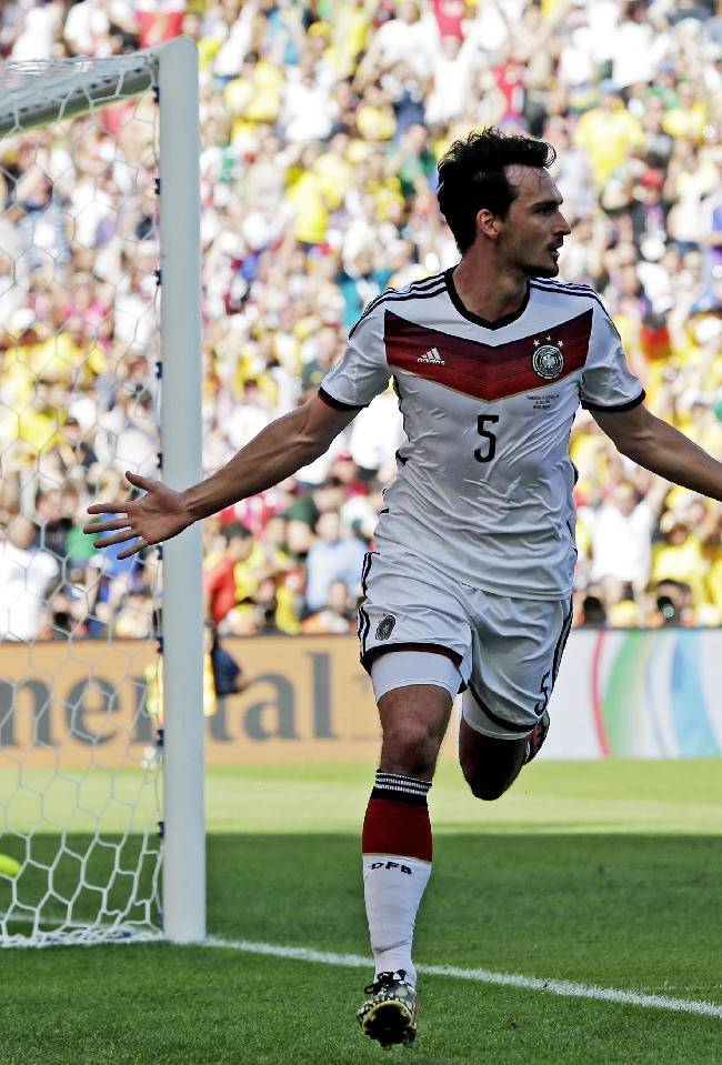 Germany's Mats Hummels celebrates after scoring his side's first goal during the World Cup quarterfinal soccer match between Germany and France at the Maracana Stadium in Rio de Janeiro, Brazil, Friday, July 4, 2014
