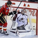 Colorado Avalanche goalie Semyon Varlamov, right, from Russia, is scored on by Calgary Flames' Dennis Wideman during the second period of an NHL hockey game, Thursday, Dec. 4, 2014 in Calgary, Alberta The Associated Press