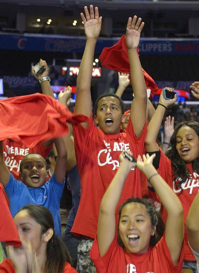 Los Angeles Clippers fans cheer inside the Staples Center during Clippers Fan Fest, Monday, Aug. 18, 2014, in Los Angeles