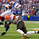 Buffalo Bills tight end Scott Chandler (84) is hit by Cleveland Browns outside linebacker Barkevious Mingo during the first half of an NFL football game, Sunday, Nov. 30, 2014, in Orchard Park, N.J The Associated Press