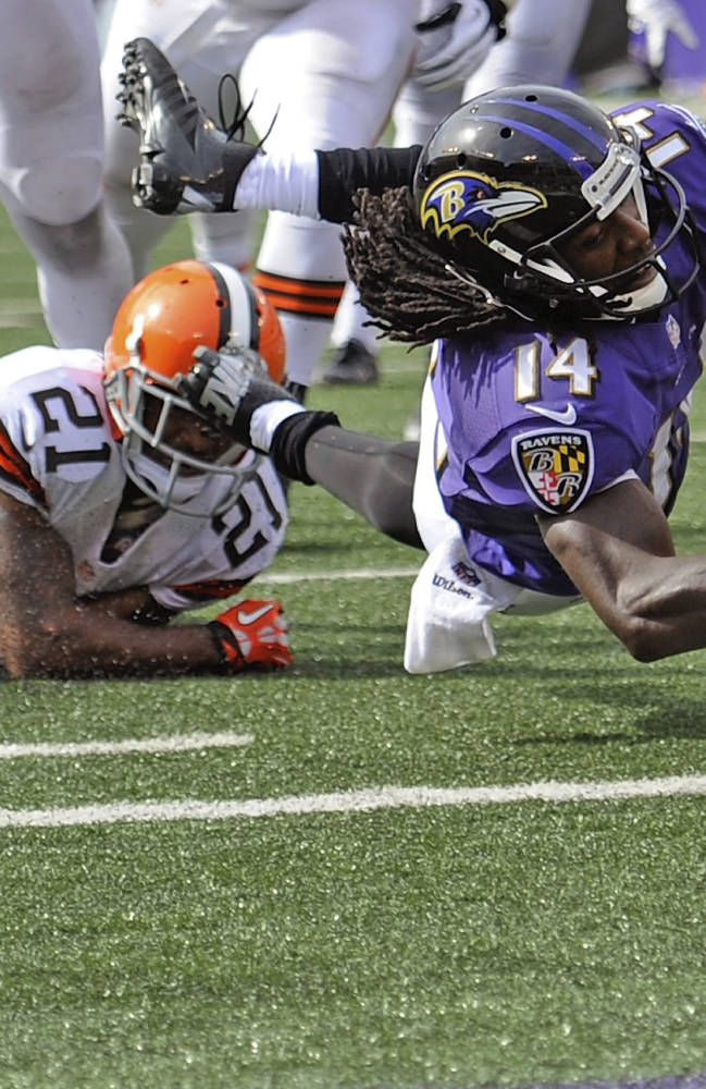 Baltimore Ravens wide receiver Marlon Brown, right, dives into the end zone past Cleveland Browns cornerback Chris Owens for a touchdown during the second half of an NFL football game in Baltimore, Md., Sundayn Sept. 15, 2013