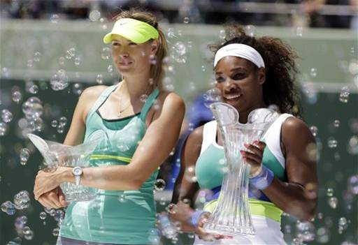 Serena Williams, right, stands with her trophy alongside Maria Sharapova, of Russia, after the final of the Sony Open tennis tournament, Saturday, March 30, 2013, in Key Biscayne, Fla. Williams won 4-6, 6-3, 6-0