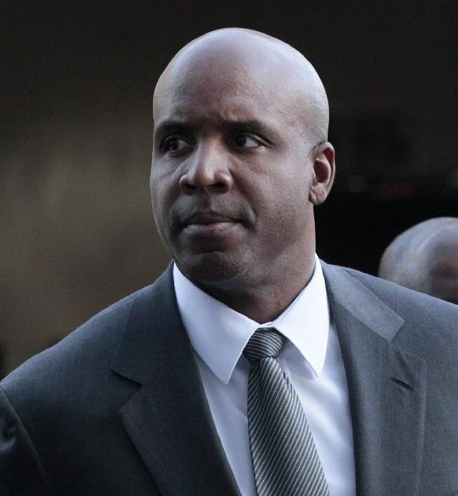 In this March 29, 2011, file photo, former baseball player Barry Bonds arrives for his trial at federal court in San Francisco. A federal appeals court in San Francisco on Friday, Sept. 13, 2013, upheld Bond's obstruction of justice conviction stemming from his 2003 testimony to a grand jury investigating performance enhancing drug use among elite athletes