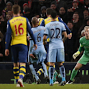 Arsenal's Olivier Giroud, third right, heads the ball past Manchester City's goalkeeper Joe Hart, left to score his sides second goal during the English Premier League soccer match between Manchester City and Arsenal at the Etihad Stadium, Manchester, En
