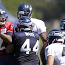 Seattle Seahawks quarterback Terrelle Pryor (2) drops back to pass at an NFL football camp practice on Saturday, July 26, 2014, in Renton, Wash The Associated Press