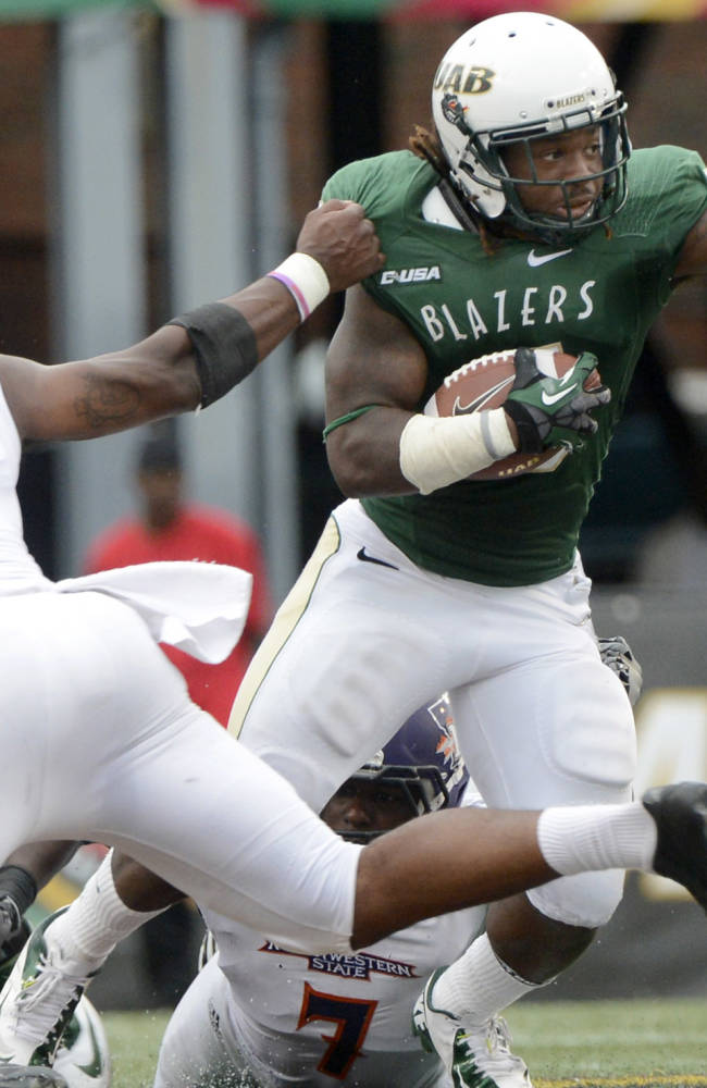 UAB running back Darrin Reaves breaks away from Northwestern State linebacker Cordarius Golston to run 50 yards for a third-quarter touchdown during an NCAA college football game at Legion Field in Birmingham, Ala., Saturday, Sept. 21, 2013. UAB won 52-28