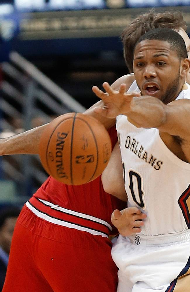 New Orleans Pelicans guard Eric Gordon (10) steals the ball from Chicago Bulls forward Mike Dunleavy during the first half of an NBA basketball game in New Orleans, Saturday, Feb. 1, 2014