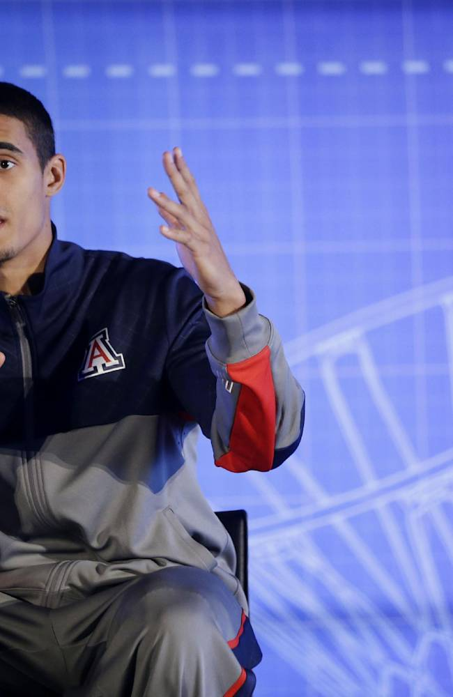 Arizona's Nick Johnson answers questions during the Pac-12 NCAA college basketball media day on Thursday, Oct. 17, 2013, in San Francisco