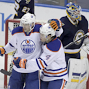 Edmonton Oilers' Benoit Pouliot (67) is congratulated by teammate Taylor Hall (4) after he scored a goal, as St. Louis Blues goalie Jake Allen (34) regroups, in the third period of a NHL hockey game, Tuesday, Jan. 13, 2015 in St. Louis. The Blues beat the