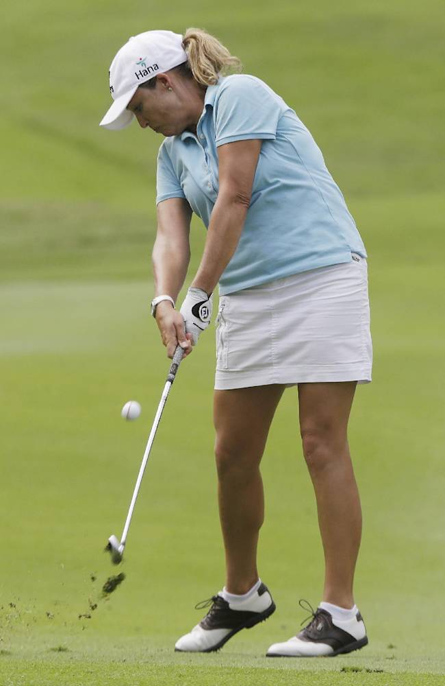 Cristie Kerr of the Us hits an approach shot  to the sixth green during her first round of the Malaysian LGPA event in Kuala Lumpur, Thursday, Oct. 10, 2013
