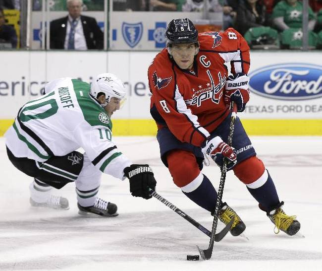 Washington Capitals' Alex Ovechkin (8), of Russia, controls the puck as he gets by Dallas Stars' Shawn Horcoff (10) in the first period of an NHL hockey game on Saturday, Oct. 5, 2013, in Dallas