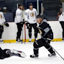 Boston Bruins left wing Brad Marchand (63) skates during NHL hockey training camp in Wilmington, Mass., Friday, Sept. 19, 2014 The Associated Press