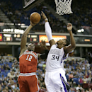 Milwaukee Bucks forward Jeff Adrein, left, has his shot blocked by Sacramento Kings forward Jason Thompson during the first quarter of an NBA basketball game in Sacramento, Calif., Sunday, March 23, 2014 The Associated Press