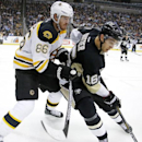 Boston Bruins' Kevan Miller (86) checks Pittsburgh Penguins' Brandon Sutter (16) in the corner during the second period of an NHL hockey game in Pittsburgh on Wednesday, Jan. 7, 2015 The Associated Press