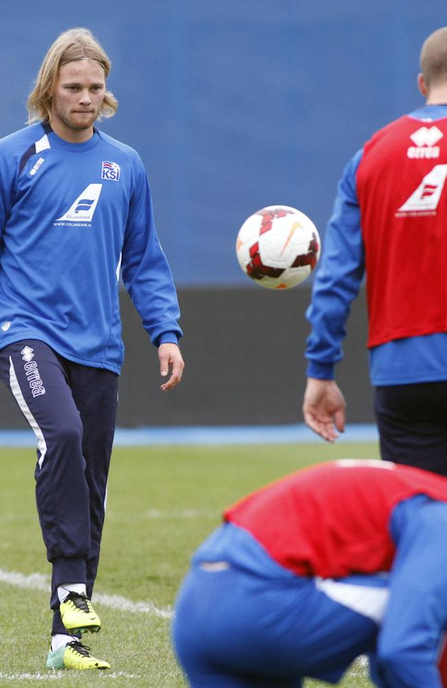Iceland's Birkir Bjarnason,left, plays the ball during a training session Monday, Nov. 18 2013, at the Maksimir stadium in Zagreb. Iceland will play Croatia on Tuesday in a World Cup qualifying playoff second-leg soccer match