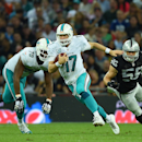 Miami Dolphins' Ryan Tannehill runs with the ball during the NFL football game against Oakland Raiders at Wembley Stadium in London, Sunday, Sept. 28, 2014. The Associated Press