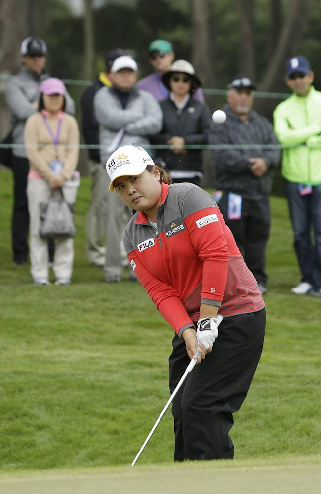 Inbee Park of South Korea chips the ball onto the 11th green of the Lake Merced Golf Club during the first round of the Swinging Skirts LPGA Classic golf tournament Thursday, April 24, 2014, in Daly City, Calif