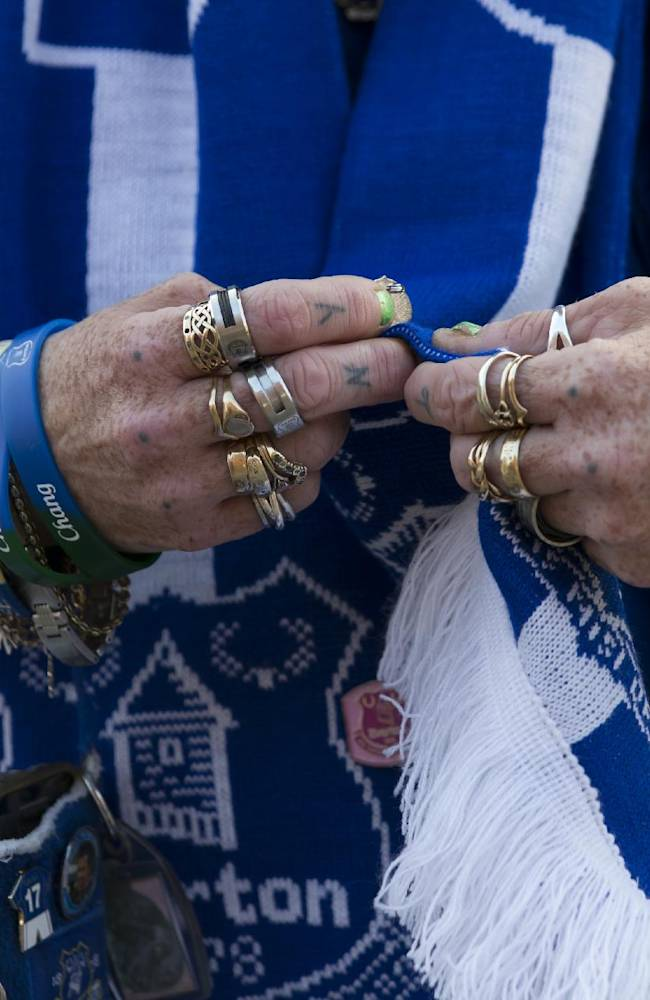 An Everton supporter adjusts her scarf before the team's Europa League Group H soccer match against Wolfsburg at Goodison Park Stadium, Liverpool, England, Thursday, Sept. 18, 2014