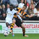 Swansea City's Nathan Dyer, left, battles with Hull City's Liam Rosenior battle for the ball during the English Premier League soccer match at the KC Stadium, Hull, England, Saturday April 5, 2014