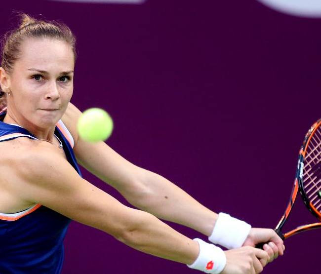 Magdalena Rybarikova of Slovakia returns the ball to Francesca Schiavone of Italy  during the second day of the WTA Qatar Ladies Open in Doha, Qatar, Tuesday, Feb. 11, 2014