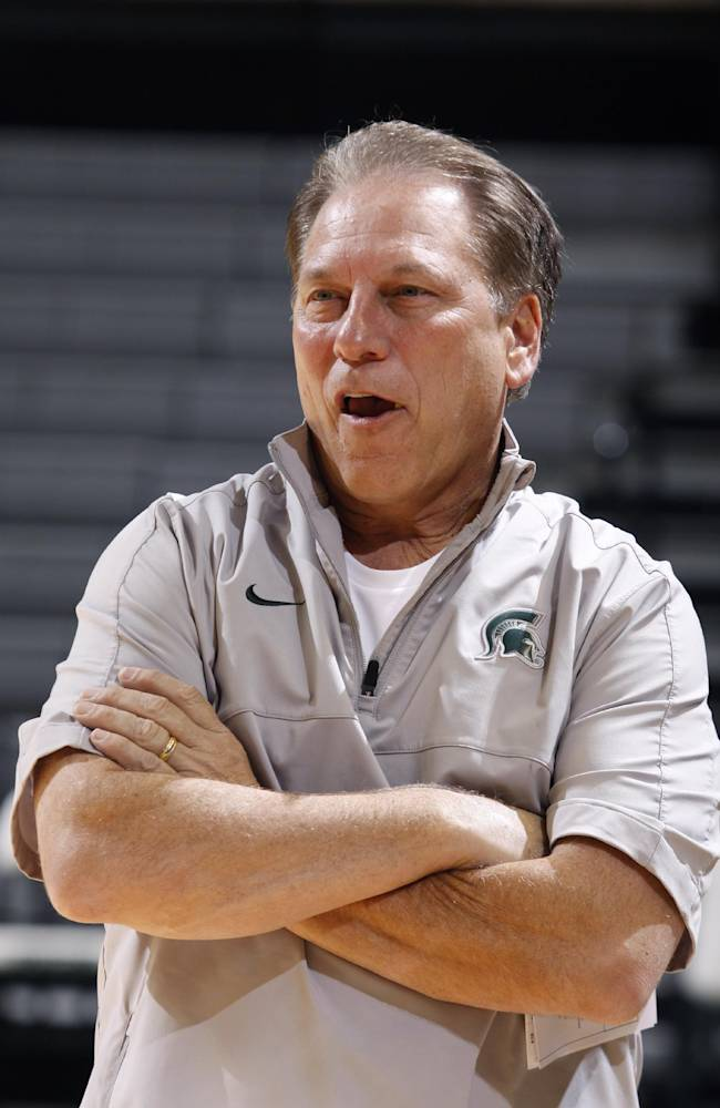 Michigan State coach Tom Izzo watches his team warm up for a practice following the team's NCAA college basketball media day, Tuesday, Oct. 22, 2013, in East Lansing, Mich